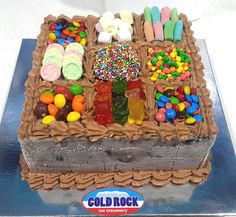 Candy box ice cream cake ready to go in our Cold Rock Cake freezer
