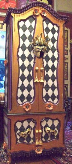"""Harlequin Armoire 82""""H a re-purposed piece with hand-painted ceramic masks & flowers with over 2000 Swarovski crystals, drops & beads."""