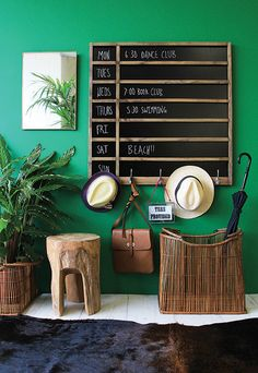 Great casual entry way! You could substitute some african baskets and garden stools in a natural fiber.
