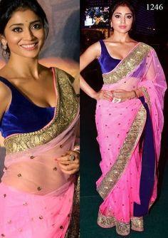 Bollywood Actress Shriya Saran Net Saree in Pink color