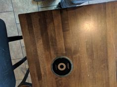 Starbucks has charging pads built in to their tables. We've dreamed the good dream. Tesla would be proud.