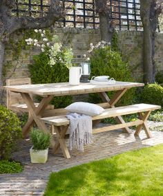 Wooden dining table, outdoors. Reclaimed teak.