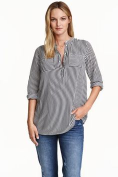 9e41f873c42734 MAMA Patterned blouse  Patterned blouse in an airy viscose weave with  pearly buttons at the
