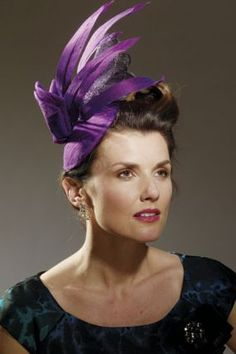How to Make a Hat Base. Fabric bow and feather embellishments transform the hat base from simple to stunning.