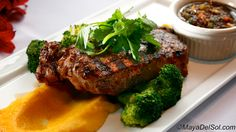 new york a la parilla | 10oz. new york strip · roasted pumpkin purée ·  truffle oil · broccoli · roasted tomato-garlic sauce