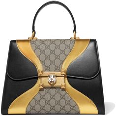 Gucci Osiride embellished leather and coated-canvas tote (€2.200) ❤ liked on Polyvore featuring bags, handbags, tote bags, gucci, black, monogrammed tote bags, metallic leather tote, genuine leather tote, leather handbag tote and monogram tote