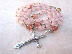 Check out this item in my Etsy shop https://www.etsy.com/ca/listing/65736750/handmade-pink-rose-quartz-rosary-beads