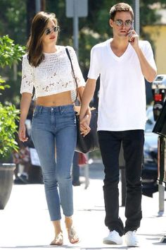 Miranda Kerr wearing Mansur Gavriel Leather Bucket Bag, Prada Gold Metallic Leather Thong Sandals, Ray-Ban 50mm Rounded Sunglasses and Mother High Waisted Looker Ankle Fray Jeans in Asking For Trouble