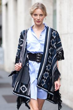 still love that shirt dress/poncho situation. #IevaLaguna #offduty in Paris.
