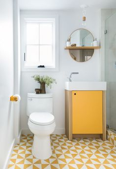 yellow floor tiles in the bathroom