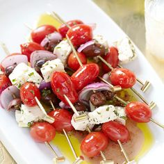 Cherry tomatoes, olives, & mozzarella cheese skewers drizzled with extra virgin olive oil, salt , pepper, and some basil for an extra kick!