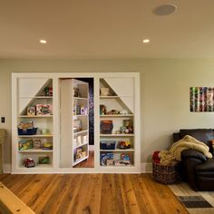 Aha!  A rotating bookself!   I wonder if we could extend the L part as a door that could cover the stairwell and stop noise from going upstairs to the living room? --Home Office Bookshelves Design, Pictures, Remodel, Decor and Ideas - page 24