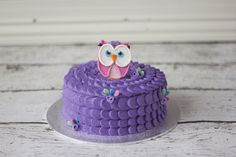 Eva's smash cake - vanilla cake with purple buttercream petal icing, topped with an edible gumpaste owl - Eva's Cupcakes