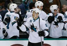 San Jose Sharks forward James Sheppard is congratulated by the Sharks bench after scoring a first period goal (Nov. 8, 2014).