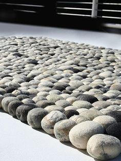 You Won't Stub Your Toe on This Faux Pebble Rug  ...how cool - what if you set this flush into flooring????