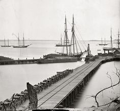 """1865. """"City Point, Virginia. Wharf, Federal artillery, and anchored schooners."""" From photographs of the main Eastern theater of war, the siege of Petersburg, June 1864-April 1865. Wet plate glass negative."""