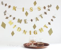 Your NYE party won't be complete without this kiss me at midnight garland.