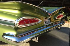1959 Impala.  My God, its smiling back at me!  What a beautiful car.