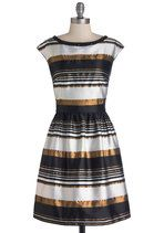 Your flat has been transformed into a festive wonderland, and donning this striped dress ensures that you fit in flawlessly! Each stripe of black, silver, and sparkling bronze on this fully lined look adds additional panache and pizzazz to your evening ensemble, while the beaded neckline provides subtle, eye-catching sheen. Accent the hidden back-zip of this dress with a wrist of bangles and black peep toes for a luxe look that's sure to dazzle!