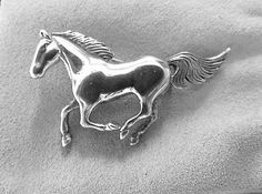 Vintage handcrafted sterling silver horse brooch.  Perfect equestrian pin for Kentucky Derby, or just a day at the races.  Signed sterling.  I have left the patina as is an...