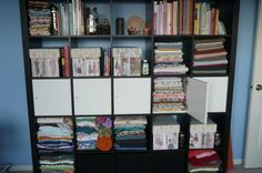 sewing room reorganization! Expedit Ikea Bookcase. Want one of these.
