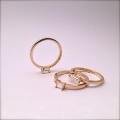 Paloma, Penelope and Calliope diamond rings set in 18k yellow gold in our Williamsburg shop