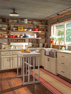 Items salvaged from old mills and barns become the floors, ceiling, and shelves in this couple's rustic kitchen