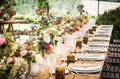 Rustic Table Setting Adorned with Bright Wild Flower Centrepieces | Destination Wedding | 1930s Style Wedding | At Le Regge In Italy | Styling by Event Planning From Italian Eye | Flowers By Stiatti Fiori | Images by Adriana Chechi | http://www.rockmywedding.co.uk/olivia-guido/