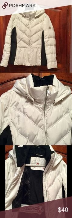 """Pristine black/ white jacket. flattering! warm!! Brilliant white and black, immensely flattering. The black blocking on each side makes your frame look long and lean. Very very warm, perfect for skiing. NEVER WORN. High end details. The fleece lining in the hood as well is so soft and yummy😍. Cutest snow bunny on the slopes❤❤ Pit to pit: 19"""" shoulder to hem: 24"""", sleeve: 24"""". ZeroXposur Jackets & Coats Puffers"""