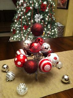 Interior: Beautiful Easy Christmas Centerpieces For Your Home, Wooden table with red white silver balls on base metal next to christmas tree