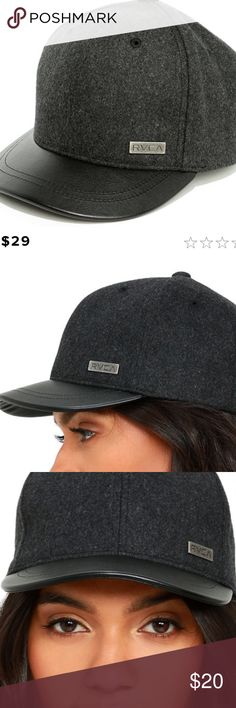 "Charcoal Grey and Black Baseball Cap Keep your cool running around town with the RVCA Charcoal Grey and Black Baseball Cap! A soft wool blend, with faux leather bill, gives this classic baseball cap design an upgrade. Adjustable VELCRO® at back, and metal logo tag on front. Slightly rounded bill measures 6"". 22"" interior circumference. 52% Polyester, 27% Wool, 21% Rayon. Imported. Accessories Hats"