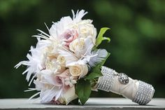 flowers with feathers for weddings - Google Search