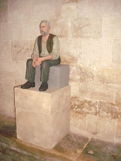 Old man seated inside cathedral