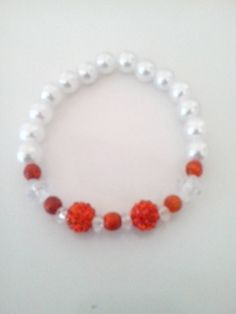 Check out this item in my Etsy shop https://www.etsy.com/listing/173921037/charming-white-pearls-orange-beaded