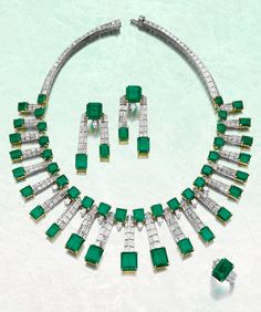 Emerald and diamond parure, de Grisogono. This striking, geometric parure features a necklace composed of two lines of baguette diamonds with step-cut emeralds and emerald pendants. Emerald Pendant, Emerald Necklace, Pendant Set, Diamond Tiara, Emerald Diamond, Diamond Jewelry, Emerald Green, Silver Jewelry, High Jewelry