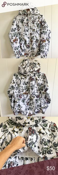 Floral Rain Jacket NWOT Floral print rain jacket. Perfect, like new condition. 100% Polyester. Jackets & Coats