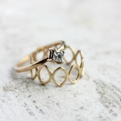 moiraklime on Etsy: princess-cut engagement ring and repeating navette band