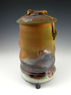 This elegant one-of-a-kind Temple Jewel Raku style individual size urn has an…