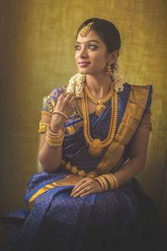 South Indian Bride Looking Stunning in a Royal Blue Kanchipuram Silk Saree