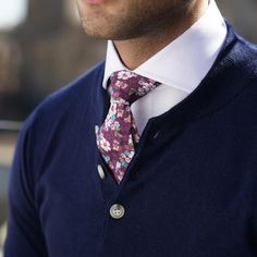 Close-up on the Carmine floral tie, Dark blue henley and White french cuff cutaway shirt.www.Grandfrank.com