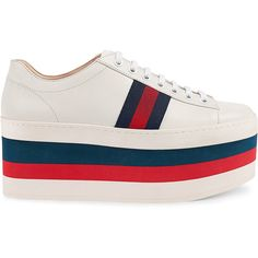 These leather sneakers have a multicolor platform in red, blue and white. A striking take on the classic lace up pays homage to Gucci's roots with the grosgra…