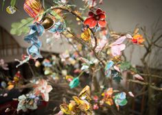On the occasion of the 150th anniversary of the world's largest food company Tinker has designed the family experience 'nest'. Detail of the handmade flowers from various product packages, by artist Rina van der Weij.
