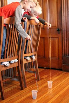 A good challenge for the kids -- try to drop the string in the cup!