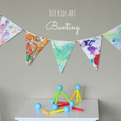 Kids art bunting - Turn their summer projects into a garland for their room!