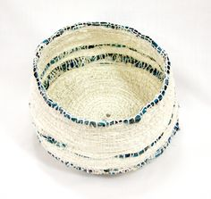 This stunning work is by Maria Ware. It's a Ghost Nets basket, 23 x 12 cm from Ngalmun Lagau Minaral Arts on Mua Island. For more info about Marie Ware and Ngalmum Lagau Minaral Arts visit http://www.gabtitui.com.au/index.php?option=com_content=article=36=33See more