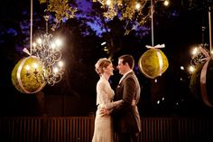 Beautifully elegant chandeliers hanging from our live oaks complement our outdoor wedding venue, Courtyard Deck.