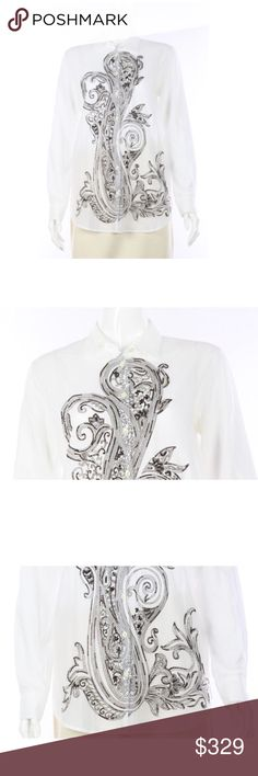 """Etro Cotton Blouse w/ Frontal Intricate Beadwork Etro White Cotton Blouse with Frontal Intricate Beadwork - Size 42  Size 42 100% Cotton Button down style Black print and brown and silver bead accents Scroll design in front Semi-sheer, lightweight, breathable fabric  Condition: Immaculate condition. Extremely tiny piling underneath. No flaws. Second hand item so has been worn.  Measurements  Length: 28"""" Arm: 25"""" Chest: 38"""" Waist: 39""""                           100% Authenticity Guarantee…"""