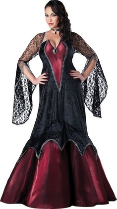 Women's Plus-Size Midnight #Vampire dress with long lace sleeves. Love the burgundy color and the silver brooche attached to the bodice. http://www.halloweendivas.com/sexy-plus-size-vampire-costumes/ #Halloween