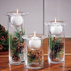 Holiday Lights Hurricanes: Very cute Christmas decoration.Holiday Lights Hurricanes, Superbly versatile glass holders come with the candles, faux greenery and pinecones shown. the inner decor can be changed o Cute Christmas Decorations, Winter Wedding Decorations, Christmas Centerpieces, Halloween Decorations, Floating Candles Wedding, Candle Wedding Centerpieces, Candle Decorations, Decoration Crafts, Holiday Lights