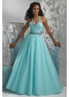 Tulle ballgown featuring ruched bodice with  jeweled waistband and necklace-style halter straps Prom Dresses
